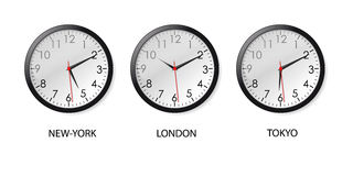Time zones. Mechanical clocks displaying time in three big cities Royalty Free Stock Images