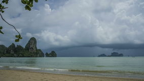 Timelaps of Rain Clouds Moving Towards the Beach, Limestone Cliff Rocks on Background, Railay Beach Krabi Thailand stock video