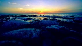 Timelapse of Amazing Sunset over the coast of stock footage