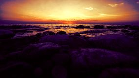 Timelapse of Amazing sunset on the pebble beach stock video