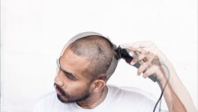 Timelapse of asian man cut his hair by himself stock video footage