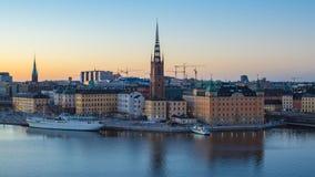 Timelapse av dagen för Stockholm stadshorisont till nattetidschackningsperioden, video 4K arkivfilmer
