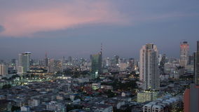 Timelapse of Bangkok city in evening and at night. Timelapse panning shot of night changing evening in Bangkok, Thailand. Panoramic city view with transport stock footage