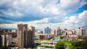 Timelapse of beautiful cloud and sky on cityscape background in Novosibirsk stock video