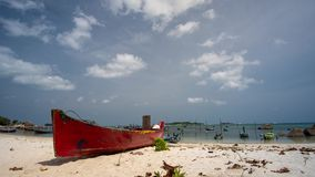 Timelapse of beautiful cloud in tropical island of Belitung Indonesia - Tanjung Kelayang with small wooden boat as foreground stock video footage
