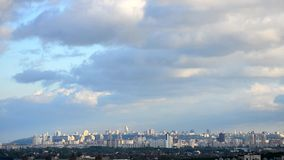 Timelapse. Beautiful cumulus clouds and shadows. Time lapse of cloudscape with beautiful cumulus clouds moving over scenic urban cityscape of Kiev, capital of stock video