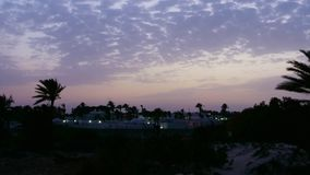Timelapse beautiful sky and palm trees during evening sunset in summer city. Timelapse beautiful sky during evening sunset in summer city. Colorful evening stock video footage