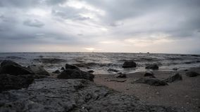 Timelapse of beautiful sunset at beach during cloudy weather and rainy day. Selective focus and crop fragment stock video