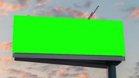 Timelapse - blank green billboard and moving sunset clouds against blue sky. Timelapse: wide blank green billboard or large display and moving clouds against stock video footage