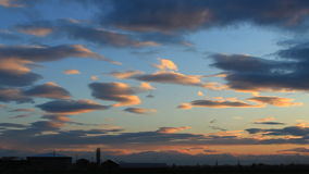 Timelapse of blue, orange, gray clouds on background blue sky stock video
