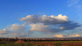 Timelapse of blue, orange, gray clouds on background blue sky, stock footage