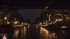 Timelapse of boat tour on Amsterdam canals at night stock video