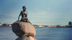 Timelapse of boat traffic by the Little Mermaid statue stock video footage