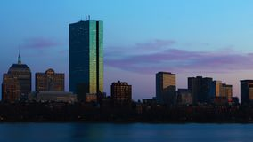 Timelapse of the Boston city center across the harbor at night 4K. A Timelapse of the Boston city center across the harbor at night 4K stock video footage