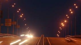 Timelapse of bridge highway traffic, dusk cars drive lights on. Stock footage stock video