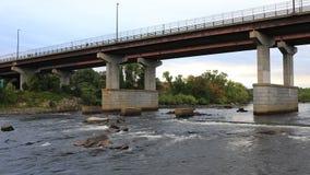 Timelapse of Bridge and Merrimack River Manchester, New Hampshire 4K. A Timelapse of Bridge and Merrimack River Manchester, New Hampshire 4K stock video
