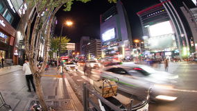 Timelapse of busy night street in Seoul, South Korea. SEOUL, SOUTH KOREA - OCTOBER 22, 2015: Timelapse panning and wide angle shot of busy city street at night stock video