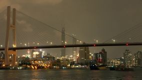 Timelapse,busy shipping on river,across the sea bridge,Brightly urban building. stock footage