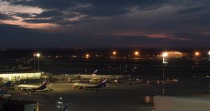 Timelapse of busy Terminal D in Sheremetyevo Airport at night. Moscow, Russia