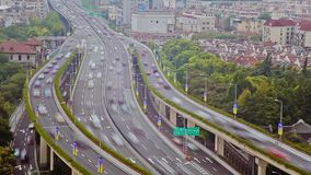 Timelapse of busy traffic over overpass in modern city , Shanghai, China stock video footage