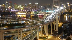 Timelapse busy urban traffic on shanghai overpass bridge at night,china. Freeway busy city rush hour heavy traffic jam highway Shanghai at night,the light stock video