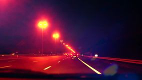 Timelapse of car driving on highway at night road. Blurred city lights stock video