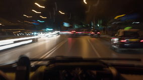 Timelapse of car driving in night city, inside view stock video