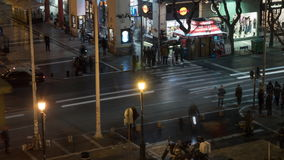 Timelapse of car and people traffic in evening street. THESSALONIKI, GREECE - JANUARY 17, 2016: Timelapse shot of evening town. Transport traffic and people stock footage