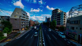 A timelapse of car street at Kanpachi avenue in Tokyo daytime wide shot. A timelapse of car street at the avenue daytime wide shot. Setagaya district Tokyo Japan stock footage