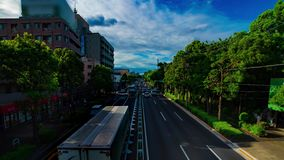 A timelapse of car street at Kanpachi avenue in Tokyo daytime wide shot zoom. A timelapse of car street at the avenue daytime wide shot zoom. Setagaya district stock footage