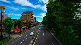 A timelapse of car street at Kanpachi avenue in Tokyo daytime wide shot zoom. A timelapse of car street at the avenue daytime wide shot zoom. Setagaya district stock video