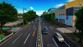 A timelapse of car street at Kanpachi avenue in Tokyo daytime wide shot panning. A timelapse of car street at the avenue daytime wide shot panning. Setagaya stock video footage
