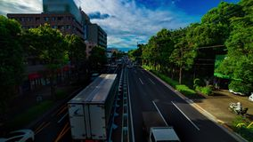 A timelapse of car street at Kanpachi avenue in Tokyo daytime wide shot tilt. A timelapse of car street at the avenue daytime wide shot tilt. Setagaya district stock video