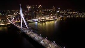 Timelapse of car traffic on Erasmus Bridge in night Rotterdam. Timelapse shot of transport traffic in Erasmus Bridge and ship sailing along the river on stock video