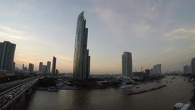 Timelapse - Chao phraya river of Bangkok city. Day to night footage stock footage