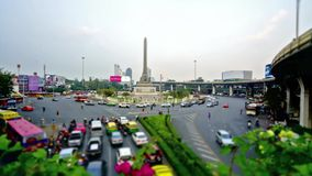 Victory monument in Thanon Phaya Thai square in Bangkok. Timelapse of the chaotic traffic in Thanon Phaya Thai square in Bangkok, Thailand stock video