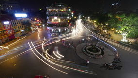 Timelapse of city square with traffic at night. Hanoi, Vietnam. HANOI, VIETNAM - OCTOBER 27, 2015: Timelapse high angle shot of transport traffic on the square stock footage