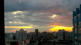Timelapse of City during warm amazing sunset and stock footage