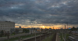 Timelapse cityscape with railway tracks and movement of passenger train stock footage