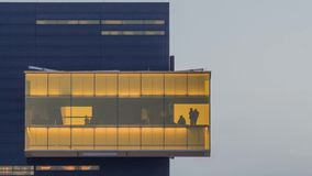 Minneapolis, MN - February 2019 - a telephoto close up shot of a yogi inside the iconic amber box of the Guthrie Theater stock video footage