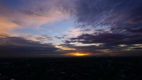 Timelapse Cloud daytime ot nighttime of The outskirts of Bangkok Thailand. Day to night stock video footage