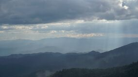 Timelapse cloud moving and Sun Ray light over Chiangmai mountain, Thailand.