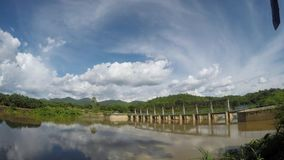 Timelapse clouds and blue sky at the dam stock video footage