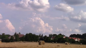 Timelapse clouds field of straw bale stock video