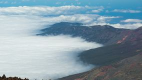 Timelapse of a clouds moving in the mountains volcano Teide on Tenerife, Canary Islands Spain. Timelapse of a clouds moving fast in the mountains volcano Teide stock video