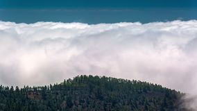 Timelapse of a clouds moving in the mountains volcano Teide on Tenerife, Canary Islands Spain. Timelapse of a clouds moving fast in the mountains volcano Teide stock video footage