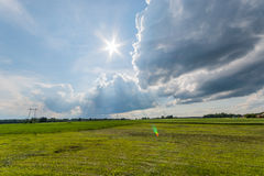 Timelapse clouds moving over the field. Spring landscape footage. Clouds moving over the field. Spring landscape with road. Timelapse footage Royalty Free Stock Photos