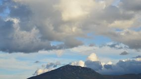 Timelapse of a clouds over mountain stock footage