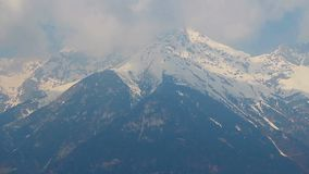 Timelapse of clouds over snowy mountain peaks, Austrian Alps stock video footage