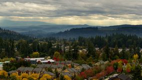 Timelapse of clouds over suburban homes in Happy Valley Oregon Fall Season 4k uhd. Ultra HD 4k timelapse movie of gray sky and dark clouds over suburban houses stock video